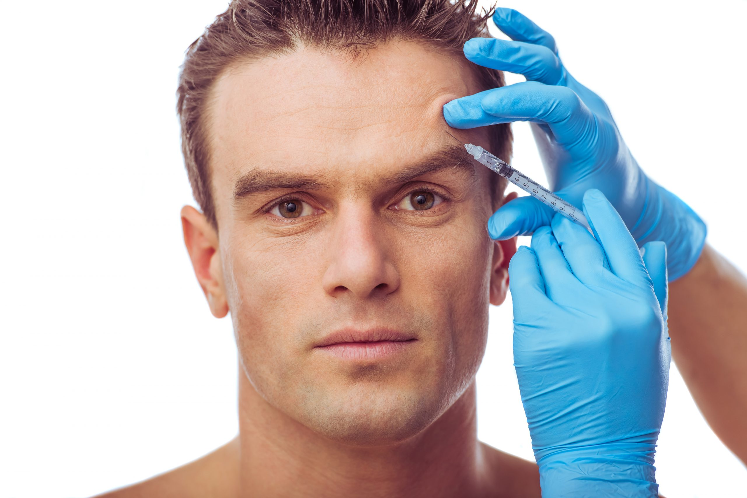 Portrait of handsome man having injections of botox, isolated on white background